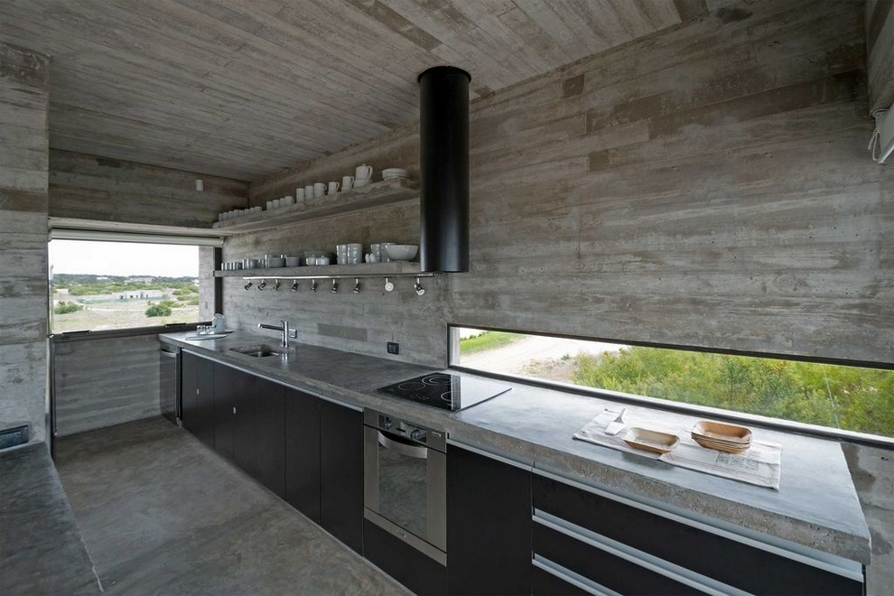 concrete house a nest for tough guys designed by luciano kruk - Concrete House