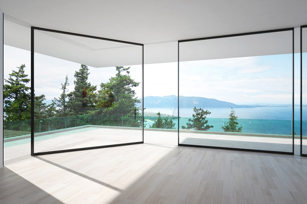Vitrocsa 39 s glass walls slide around corners to serve your for Sliding glass walls