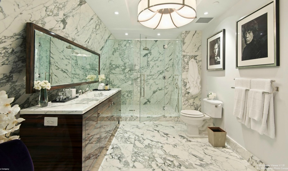 the-bathroom-is-done-completely-in-marble-with-a-full-glass-shower
