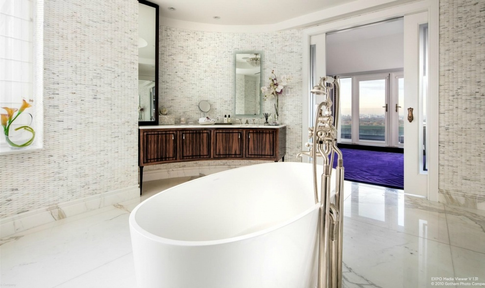 the-master-bath-has-a-luxurious-tub-in-the-middle-of-the-room
