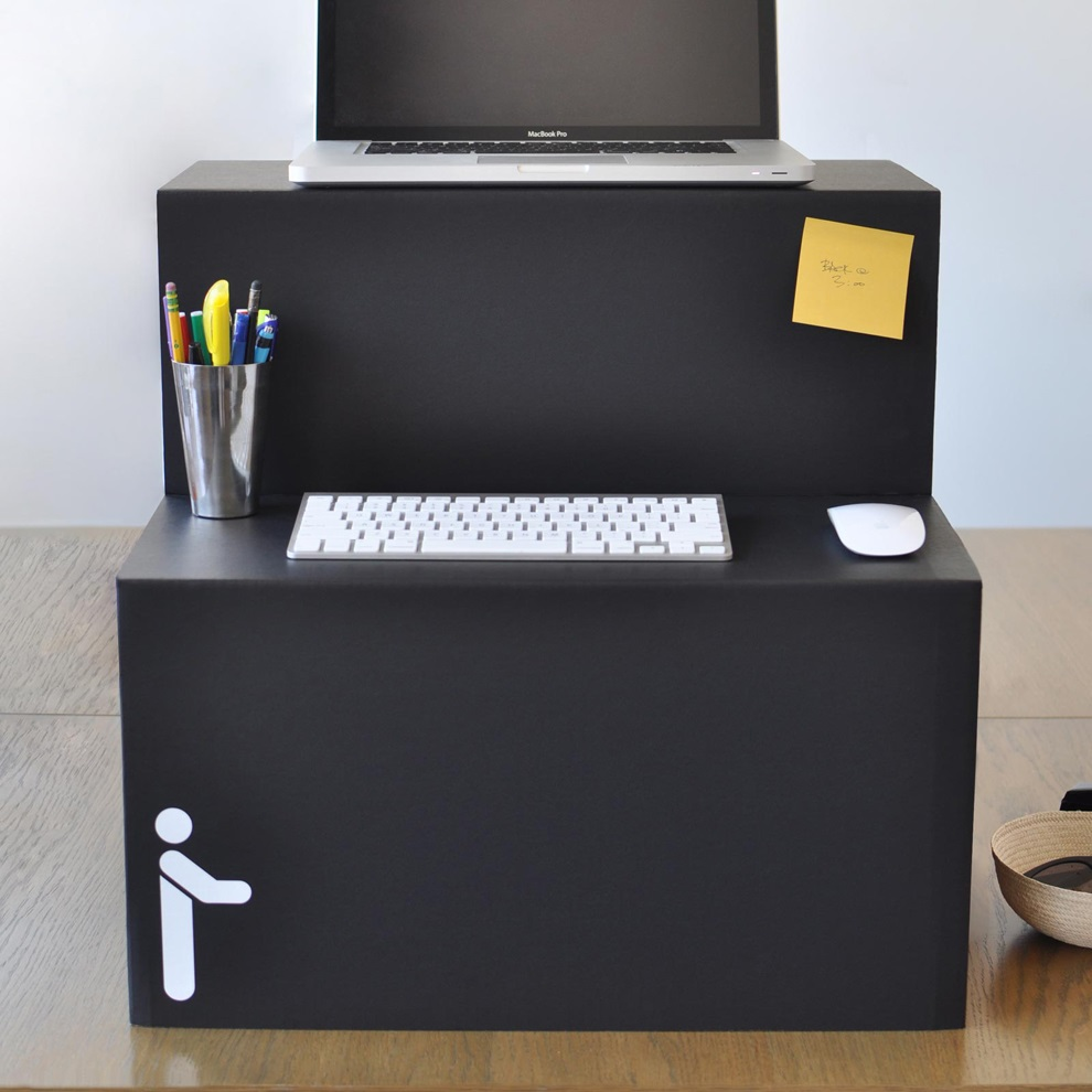 flat packed standing desk is made entirely out of cardboard. Black Bedroom Furniture Sets. Home Design Ideas